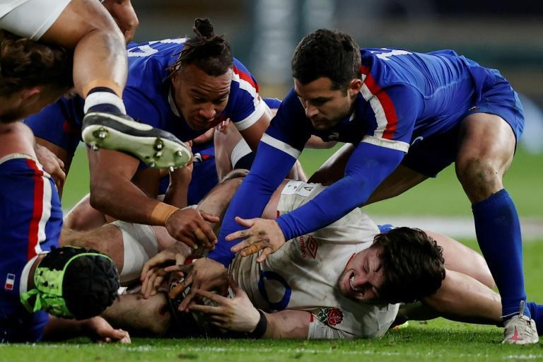 Turnover king - England flanker Tom Curry (floor) steals the ball against France