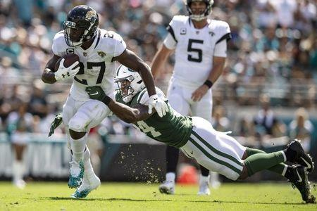 FILE PHOTO: Sep 30, 2018; Jacksonville, FL, USA; Jacksonville Jaguars running back Leonard Fournette (27) runs the ball against New York Jets linebacker Avery Williamson (54) during the first half at TIAA Bank Field. Mandatory Credit: Douglas DeFelice-USA TODAY Sports