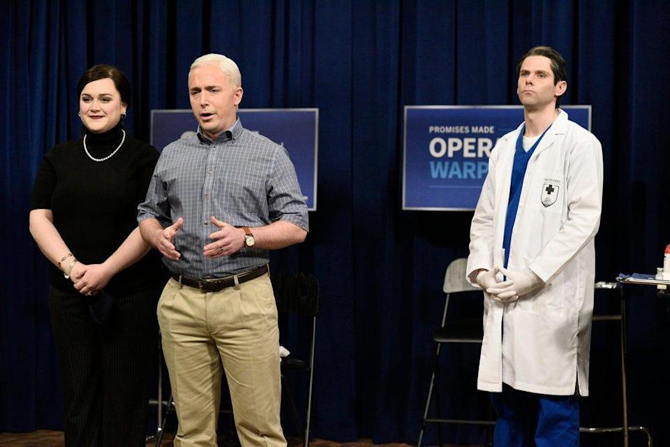 """Pictured: (l-r) Lauren Holt as Karen Pence, Beck Bennett as Mike Pence, and Mikey Day as a healthcare worker during the """"Pence Gets The Vaccine"""" Cold Open on Saturday, December 19, 2020."""