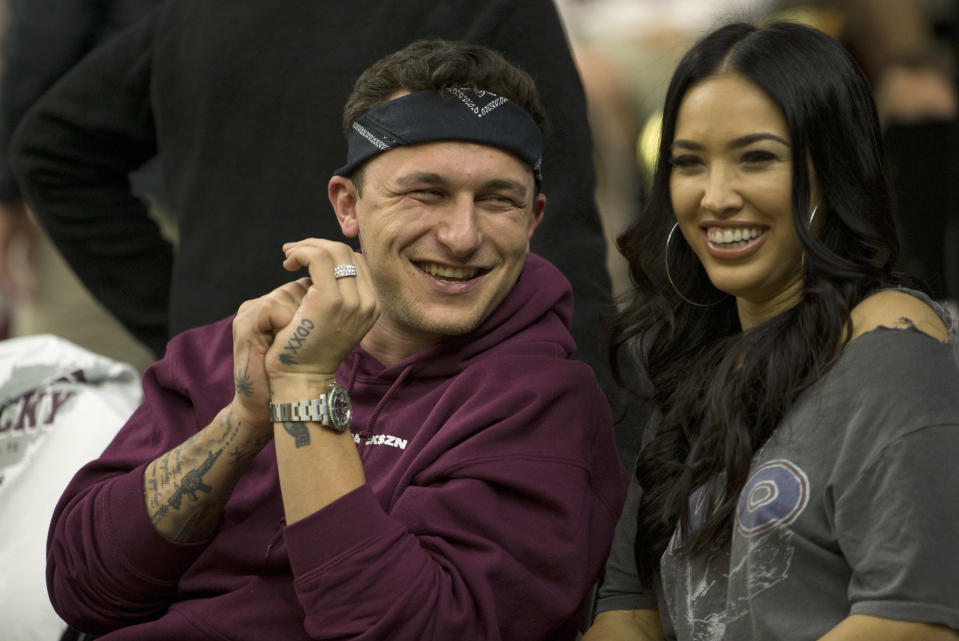 Former Cleveland Browns quarterback Johnny Manziel, shown here on Saturday at a Texas A&M basketball game with fiancee Bre Tiesi, said he's sober and wants to play in the NFL again. (AP)