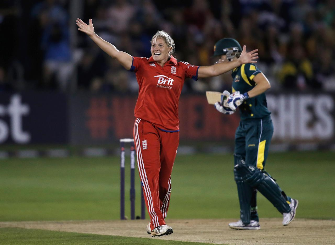 CHELMSFORD, ENGLAND - AUGUST 27:  Katherine Brunt of England celebrates dismissing Alyssa Healy of Australia (R) during the first NatWest T20 match between England and Australia at the Ford County Ground on August 27, 2013 in Chelmsford, England.  (Photo by Harry Engels/Getty Images)