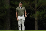 Rory McIlroy, of Northern Ireland, reacts to his chip shot to the 14th green during the first round of the Masters golf tournament Friday, Nov. 13, 2020, in Augusta, Ga. (AP Photo/Matt Slocum)
