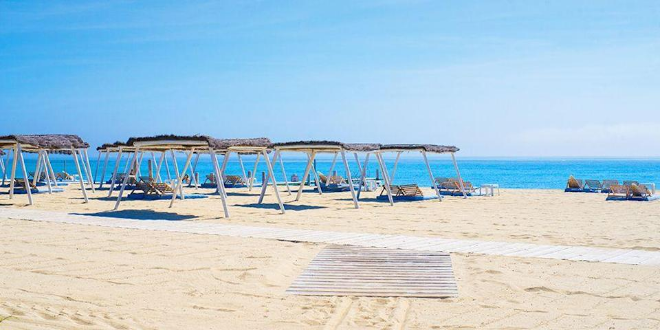 """<p>The crown jewel of beaches along the French Riviera is <a href=""""https://www.tripadvisor.com/Attraction_Review-g196678-d568369-Reviews-Plage_de_Pampelonne-Ramatuelle_Saint_Tropez_French_Riviera_Cote_d_Azur_Provence_Al.html"""" rel=""""nofollow noopener"""" target=""""_blank"""" data-ylk=""""slk:Pampelonne"""" class=""""link rapid-noclick-resp"""">Pampelonne</a>, the busiest and longest stretch in glamorous St. Tropez. Bring a towel and stake out a spot in the public area, or spend the day at one of the see-and-be-seen beach clubs like <a href=""""https://www.tripadvisor.com/Restaurant_Review-g196678-d2194772-Reviews-Le_Club_55-Ramatuelle_Saint_Tropez_French_Riviera_Cote_d_Azur_Provence_Alpes_Cote.html"""" rel=""""nofollow noopener"""" target=""""_blank"""" data-ylk=""""slk:Le Club 55"""" class=""""link rapid-noclick-resp"""">Le Club 55</a>.</p><p><a class=""""link rapid-noclick-resp"""" href=""""https://go.redirectingat.com?id=74968X1596630&url=https%3A%2F%2Fwww.tripadvisor.com%2FHotel_Review-g187242-d219945-Reviews-Hotel_des_Lices-Saint_Tropez_French_Riviera_Cote_d_Azur_Provence_Alpes_Cote_d_Azur.html&sref=https%3A%2F%2Fwww.redbookmag.com%2Flife%2Fg34756735%2Fbest-beaches-for-vacations%2F"""" rel=""""nofollow noopener"""" target=""""_blank"""" data-ylk=""""slk:BOOK NOW"""">BOOK NOW</a> Hotel des Lices</p><p><a class=""""link rapid-noclick-resp"""" href=""""https://go.redirectingat.com?id=74968X1596630&url=https%3A%2F%2Fwww.tripadvisor.com%2FHotel_Review-g187242-d197818-Reviews-Hotel_Byblos_Saint_Tropez-Saint_Tropez_French_Riviera_Cote_d_Azur_Provence_Alpes_Cote_d.html&sref=https%3A%2F%2Fwww.redbookmag.com%2Flife%2Fg34756735%2Fbest-beaches-for-vacations%2F"""" rel=""""nofollow noopener"""" target=""""_blank"""" data-ylk=""""slk:BOOK NOW"""">BOOK NOW</a> Hotel Byblos</p>"""