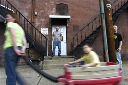 Bruce Zigarski (C), 60, a retired heavy equipment operator, stands on the steps of his apartment building, in Shamokin May 1, 2014. REUTERS/Mark Makela