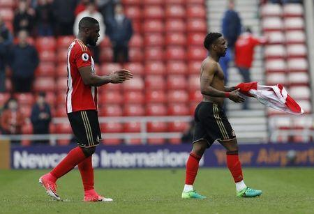 Britain Football Soccer - Sunderland v AFC Bournemouth - Premier League - Stadium of Light - 29/4/17 Sunderland's Jermain Defoe and Victor Anichebe look dejected after Sunderland are relegated Action Images via Reuters / Lee Smith Livepic
