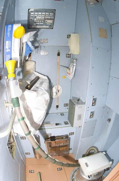 A view of the toilet compartment in the Zvezda Service Module of the International Space Station (ISS).