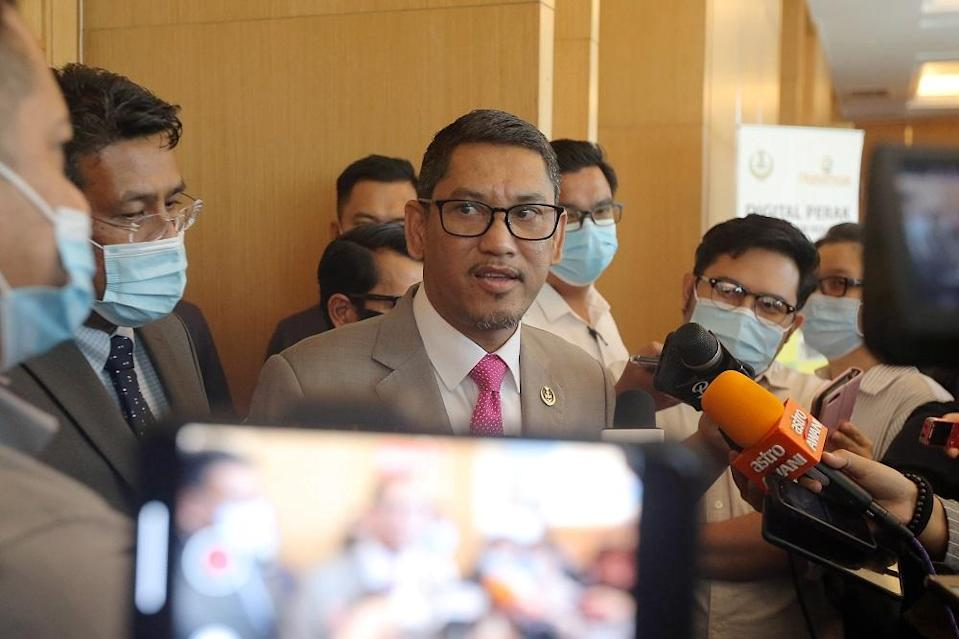 Datuk Seri Ahmad Faizal Azumu speaking to press at the Weil Hotel in Ipoh October 9, 2020. — Picture by Farhan Najibk