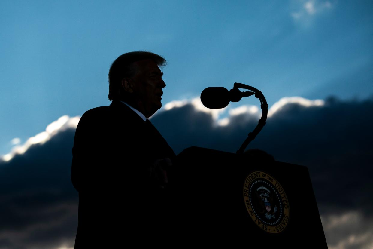 Outgoing President Donald Trump addresses guests at Joint Base Andrews in Maryland on January 20, 2021. - President Trump and the First Lady travel to their Mar-a-Lago golf club residence in Palm Beach, Florida. (Alex Edelman/AFP via Getty Images)