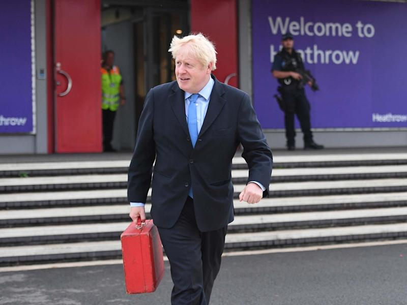 Boris Johnson boards his plane at Heathrow Airport as he heads off for the annual United Nations General Assembly in New York: PA
