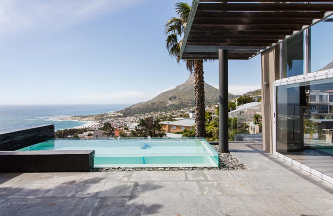 """<p>Visiting <a href=""""https://www.cntraveler.com/activities/cape-town/camps-bay-beach?mbid=synd_yahoo_rss"""" target=""""_blank"""">Camps Bay Beach</a>, the livelier of Cape Town's stretches of sand, is <a href=""""https://www.cntraveler.com/activities/cape-town/camps-bay-beach?mbid=synd_yahoo_rss"""" target=""""_blank"""">one of our must-dos</a> while visiting the South African city. Just five minutes from the beach, this three-bedroom penthouse villa is all about the views: of the beach below, Lion's Head to the north, and the iconic <a href=""""https://www.cntraveler.com/activities/cape-town/table-mountain?mbid=synd_yahoo_rss"""" target=""""_blank"""">Table Mountain</a> at its back. You can enjoy them from a private glass pool, bedroom balconies, or from inside the living room, thanks to crystal clear, floor-to-ceiling windows—take your pick.</p> <p><strong>Book now:</strong> <a href=""""https://airbnb.pvxt.net/zG7yM"""" rel=""""nofollow"""" target=""""_blank"""">From $522 per night, airbnb.com</a></p>"""
