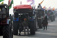 Farmers have been camped on key roads into India's capital for two months, protesting against new laws which deregulate produce markets