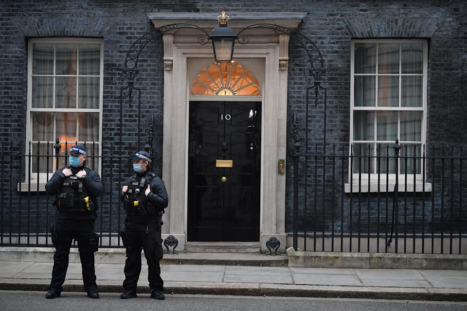 Police stand guard outside 10 Downing street in central London on March 3, 2021. - Britain is expected to keep vast emergency financial support propping up the UK's virus-battered economy when unveiling its annual budget today, but could also raise tax to fight surging debt. (Photo by JUSTIN TALLIS / AFP) (Photo by JUSTIN TALLIS/AFP via Getty Images)