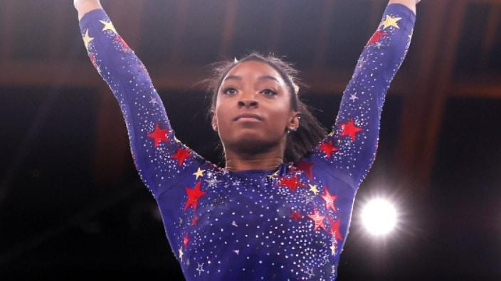 Simone Biles of Team United States competes on vault during Women's Qualification on Day Two of the Tokyo 2020 Olympic Games Sunday at Ariake Gymnastics Centre in Tokyo, Japan. (Photo by Laurence Griffiths/Getty Images)