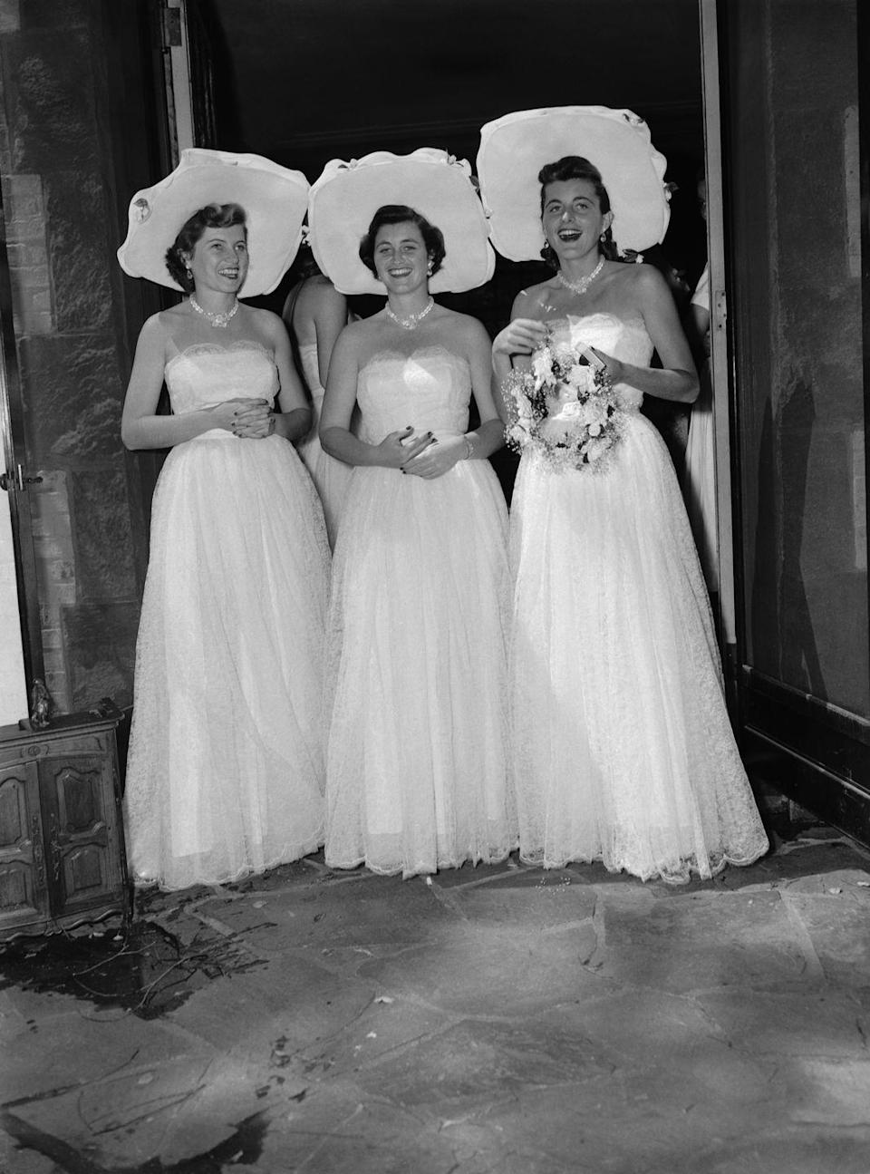 <p>Jean (center), Eunice (left), and Patricia (right), served as bridesmaids at their brother Robert's wedding to Ethel Skakel.</p>