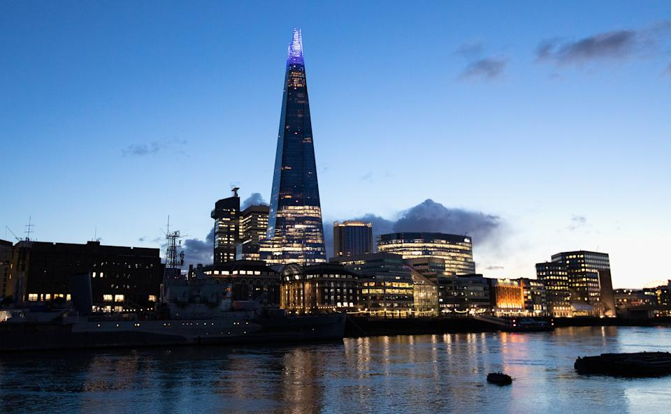 A quiet evening view of the Shard and skyline illuminated from Tower Pier in London, England. Photo: Jo Hale/Getty Images