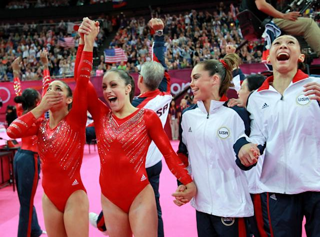 <p>Alexandra Raisman, Jordyn Wieber, McKayla Maroney Maroney and Kyla Ross of the United States celebrate during the final rotation in the Artistic Gymnastics Women's Team final on Day 4 of the London 2012 Olympic Games at North Greenwich Arena on July 31, 2012 in London, England. (Photo by Ronald Martinez/Getty Images) </p>