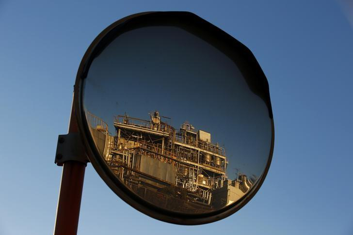 A petro-industrial factory is reflected in a traffic mirror in Kawasaki near Tokyo