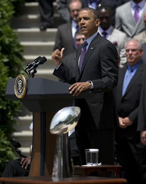 With the Vince Lombardi Super Bowl trophy in the foreground, President Barack Obama speaks on the South Lawn of the White House in Washington, Wednesday, June 5, 2013, during a ceremony honoring the Super Bowl XLVII champion Baltimore Ravens football team. The Ravens defeated the San Francisco 49ers in Super Bowl XLVII. (AP Photo/Evan Vucci)