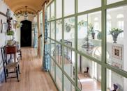 "<p>The trio continued their design up to the second floor, where a glass-paned hallways gives the illusion of a greenhouse—and allows for maximum light while still delineating the space, which is outfitted with an assortment of antiques. ""We wanted it to be fresh, but still historical,"" says Pablo of the design.</p>"