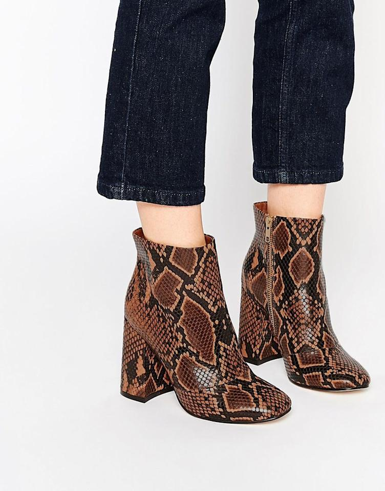 "<p>These are basically the most on-trend boot you might possibly find for this season. Just above ankle height, snakeskin, block-heeled and 70s in inspiration. They are a fashion-girl staple.</p><p><a href=""http://www.asos.com/ASOS/ASOS-EDWINA-Ankle-Boots/Prod/pgeproduct.aspx?iid=5666647&cid=6455&sh=0&pge=0&pgesize=204&sort=-1&clr=Brown+snake&totalstyles=741&gridsize=3"">£55 from ASOS</a><br /></p>"