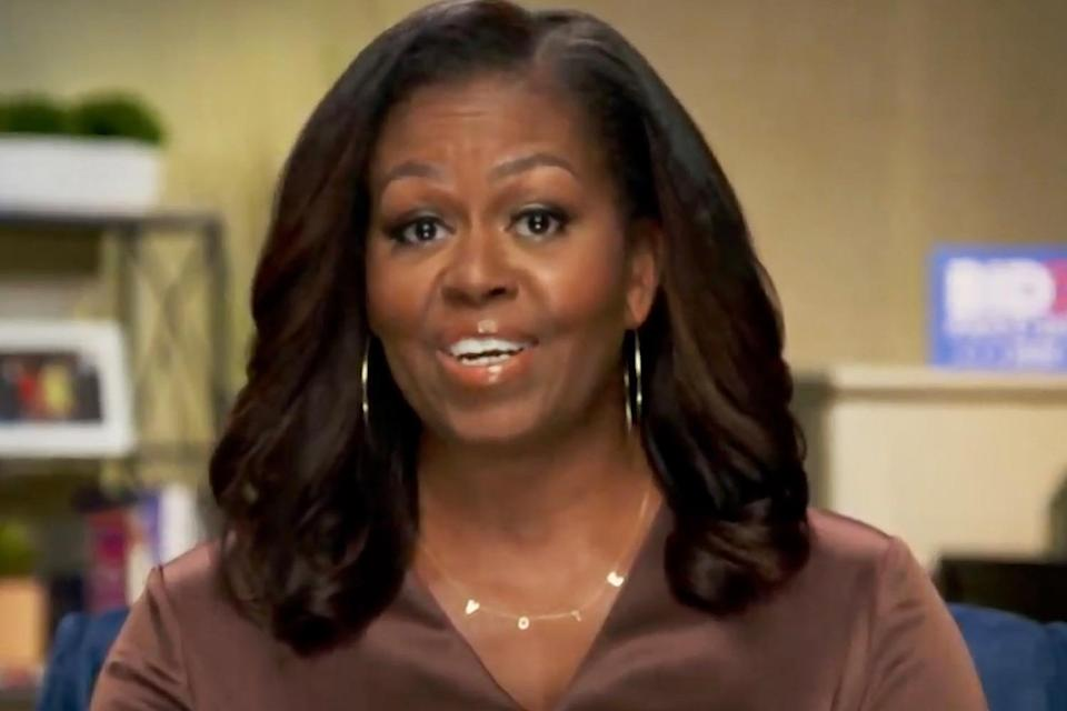 """<p>The former First Lady stole the show on the first night of the Democratic National Convention with her powerful speech — and her <a href=""""https://people.com/style/michelle-obama-vote-necklace-dnc-speech/"""" rel=""""nofollow noopener"""" target=""""_blank"""" data-ylk=""""slk:delicate """"VOTE"""" necklace"""" class=""""link rapid-noclick-resp"""">delicate """"VOTE"""" necklace</a> (custom made by ByChari) — which instantly began trending on Twitter.</p>"""