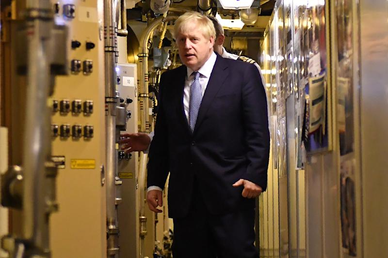Britain's Prime Minister Boris Johnson aboard Vanguard-class submarine HMS Victorious during a visit to Faslane Naval base (HM Naval Base Clyde), north of Glasgow in Scotland on July 29, 2019. - New British Prime Minister Boris Johnson makes his first official visit to Scotland on Monday in an attempt to bolster the union in the face of warnings over a no-deal Brexit. (Photo by Jeff J Mitchell / POOL / AFP) / The erroneous mention[s] appearing in the metadata of this photo by Jeff J Mitchell has been modified in AFP systems in the following manner: [HMS Victorious] instead of [HMS Vengeance]. Please immediately remove the erroneous mention[s] from all your online services and delete it (them) from your servers. If you have been authorized by AFP to distribute it (them) to third parties, please ensure that the same actions are carried out by them. Failure to promptly comply with these instructions will entail liability on your part for any continued or post notification usage. Therefore we thank you very much for all your attention and prompt action. We are sorry for the inconvenience this notification may cause and remain at your disposal for any further information you may require. (Photo credit should read JEFF J MITCHELL/AFP/Getty Images)
