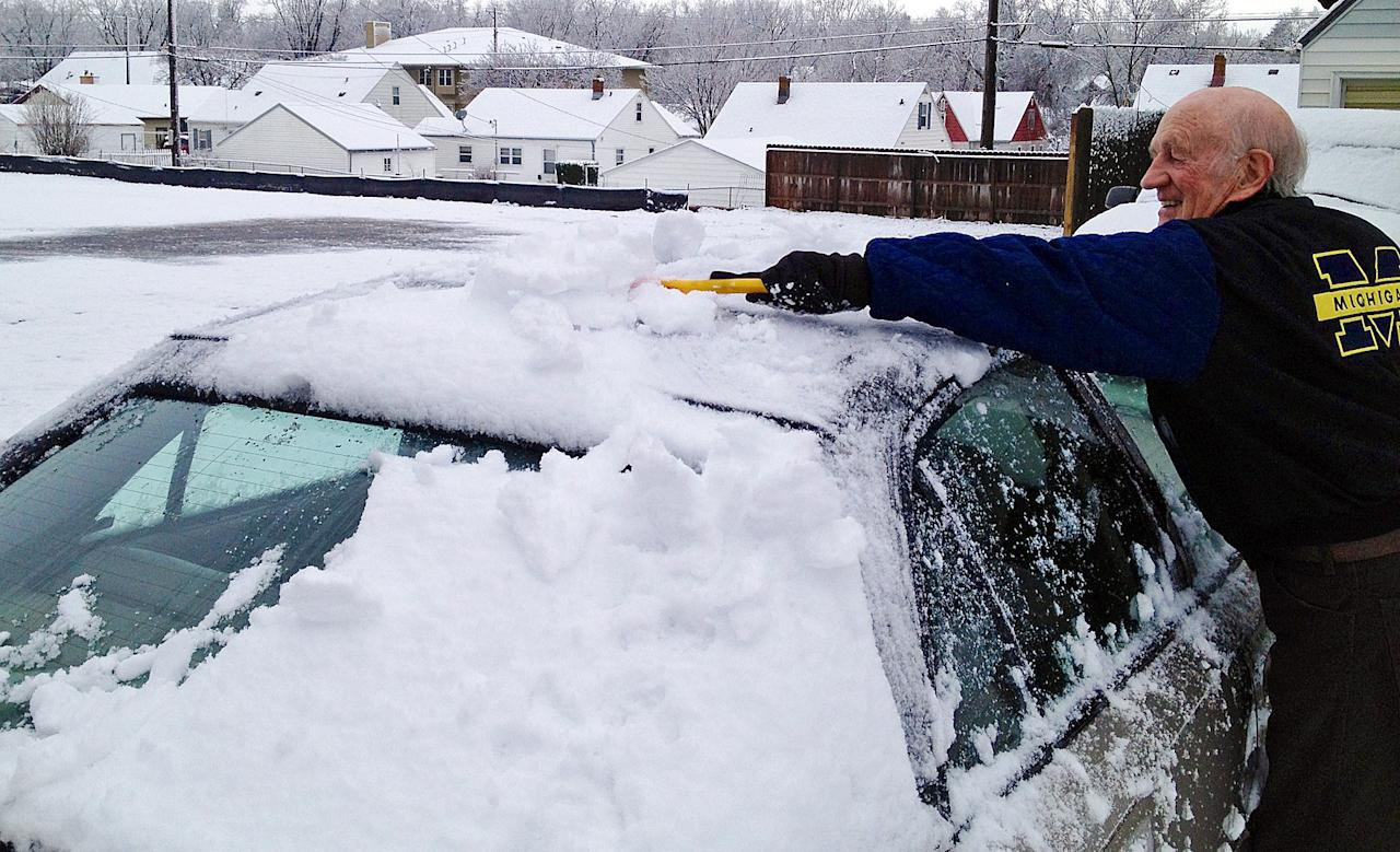 <p> Arvid Buseman clears snow off his car Wednesday morning, May 1, 2013 in central Sioux Falls, S.D. Sioux Falls, South Dakota's largest city, got its first May snowfall in 37 years Wednesday and its largest May amount since 1944. (AP Photo/The Argus Leader, Dalton Walker) NO SALES