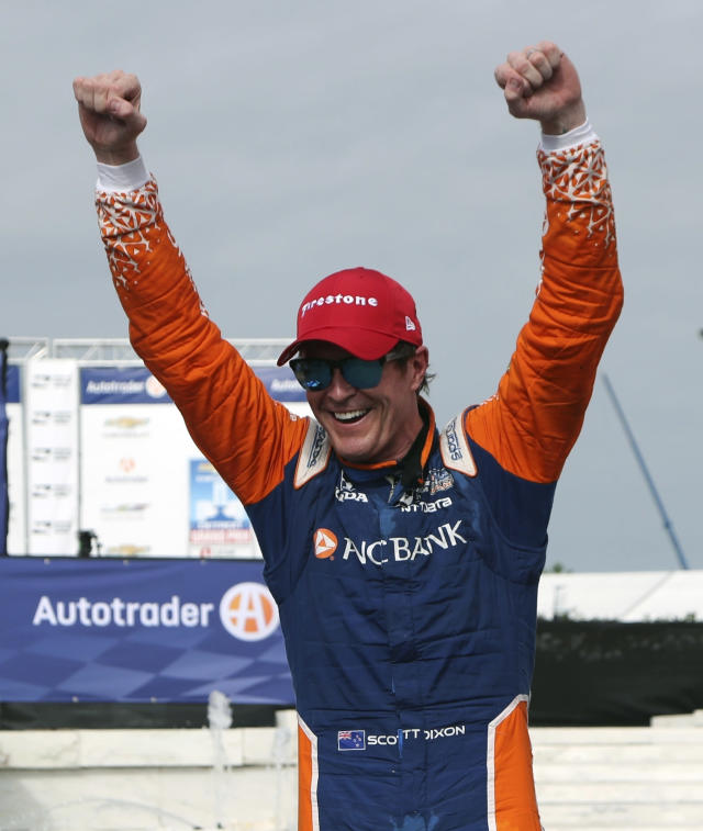 FILE - In this June 2, 2018, file photo, Scott Dixon, of New Zealand, celebrates after winning the first race of the IndyCar Detroit Grand Prix auto racing doubleheader, in Detroit. Dixon is on a roll with four top-5 finishes, including a win last week at Belle Isle, over the last four races. That victory tied Dixon for third on the career victory list, with a stop at Fort Worth coming up this weekend. (AP Photo/Carlos Osorio, File)