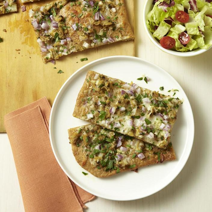 <p>Here's an easy homemade pizza recipe that is a take on white clam pizza, which was first made famous by Frank Pepe of Pepe's Pizzeria in New Haven, Connecticut. Look for fresh clam strips in the seafood department. You can find them ready to use out of their shells at most large supermarkets. If you don't want to use fresh, we also like the briny flavor and convenience of canned chopped clams.</p>