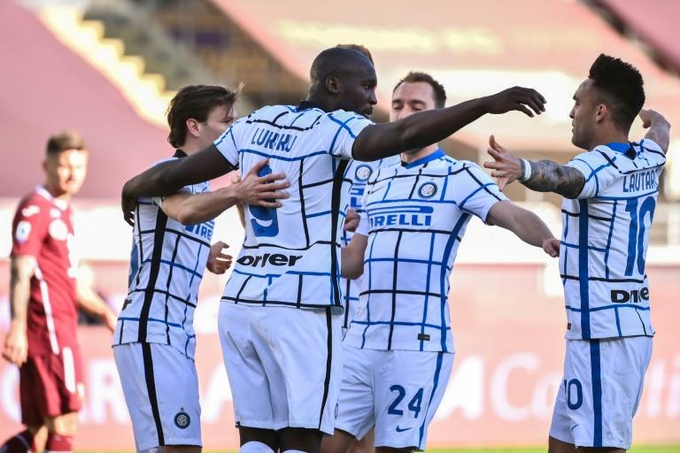 Romelu Lukaku (C) and Lautaro Martinez (R) have accounted for 33 of 65 goals scored by Inter in Serie A this season