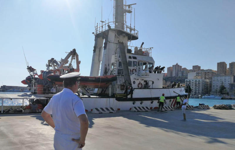 The Open Arms rescue ship is docked at the Sicilian port of Porto Empedocle, southern Italy, Wednesday, Aug. 21, 2019. An Italian prosecutor ordered the seizure of a rescue ship and the evacuation of more than 80 migrants that were aboard, capping a drama Tuesday that saw 15 people jump overboard in a desperate bid to escape deteriorating conditions on the vessel and Spain dispatch a naval ship to try to resolve the crisis. (Concetta Rizzo/ANSA via AP)