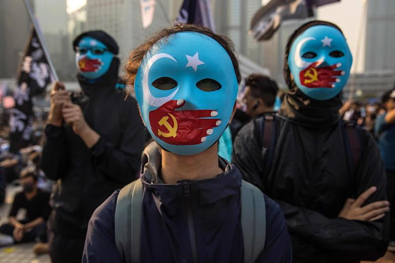 Protesters attend a rally in Hong Kong to show support for the Uighur minority in China: AFP/Getty