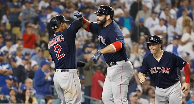 "<a class=""link rapid-noclick-resp"" href=""/mlb/players/8772/"" data-ylk=""slk:Mitch Moreland"">Mitch Moreland</a> (C) of the Boston <a class=""link rapid-noclick-resp"" href=""/mlb/teams/bos"" data-ylk=""slk:Red Sox"">Red Sox</a> celebrates with <a class=""link rapid-noclick-resp"" href=""/mlb/players/9319/"" data-ylk=""slk:Xander Bogaerts"">Xander Bogaerts</a> (L) and <a class=""link rapid-noclick-resp"" href=""/mlb/players/9292/"" data-ylk=""slk:Brock Holt"">Brock Holt</a> after hitting a three-run home run in Game 4 of the 2018 World Series at Dodger Stadium on October 27, 2018 in Los Angeles. (Getty Images)"