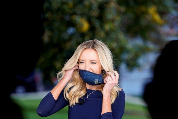 PHOTO: White House Press Secretary Kayleigh McEnany removes her mask before a television interview in Washington, Oct. 2, 2020. (Joshua Roberts/Reuters)