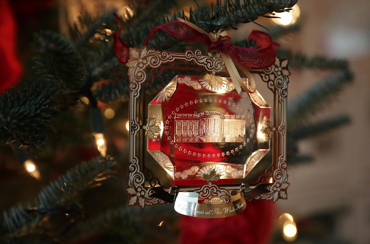 The First Family's official Christmas ornament is displayed at the White House November 26, 2018 in Washington, D.C. The 2018 theme of the White House holiday decorations is 'American Treasures,' and features patriotic displays highlighting the country's 'unique heritage.' The White House expects to host 100 open houses and more than 30,000 guests who will tour the topiary trees, architectural models of major U.S. cities, the Gold Star family tree and national monuments in gingerbread. (Photo: Chip Somodevilla/Getty Images)