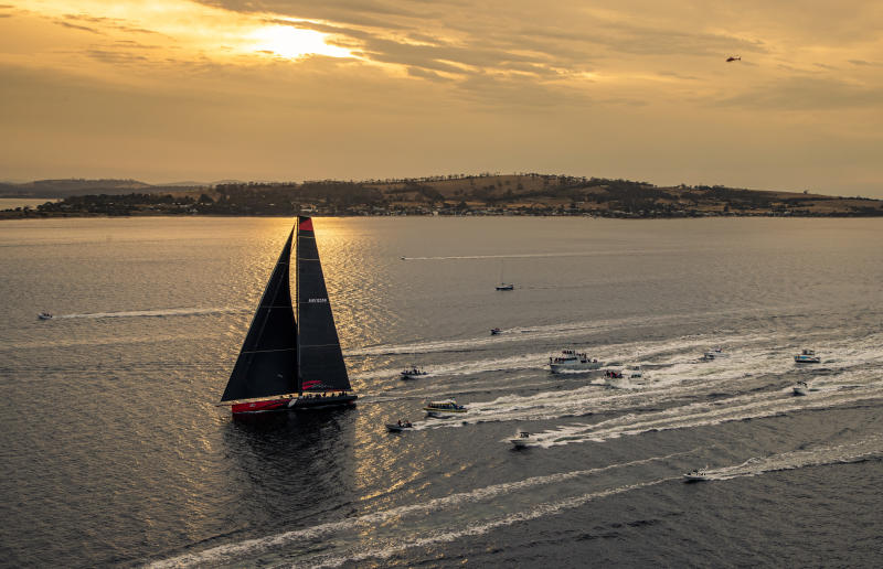 In a photo provided by Rolex, Comanche arrives to Hobart, Australia, to claim line honors in the Sydney to Hobart yacht race Saturday, Dec. 28, 2019. (Carlo Borlenghi/Rolex via AP)