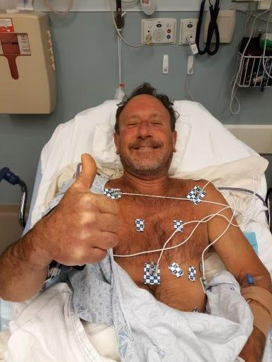 Lobster diver Michael Packard, 56, of Wellfleet, gives the thumbs up Friday morning from Cape Cod Hospital in Hyannis, where he was taken after he was injured in an encounter with a humpback whale Provincetown. He was later released from the hospital.