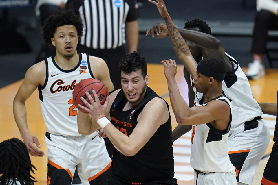 Oregon State center Roman Silva (12) pulls down a rebound against Oklahoma State during the first half of a men's college basketball game in the second round of the NCAA tournament at Hinkle Fieldhouse in Indianapolis, Sunday, March 21, 2021. (AP Photo/Paul Sancya)