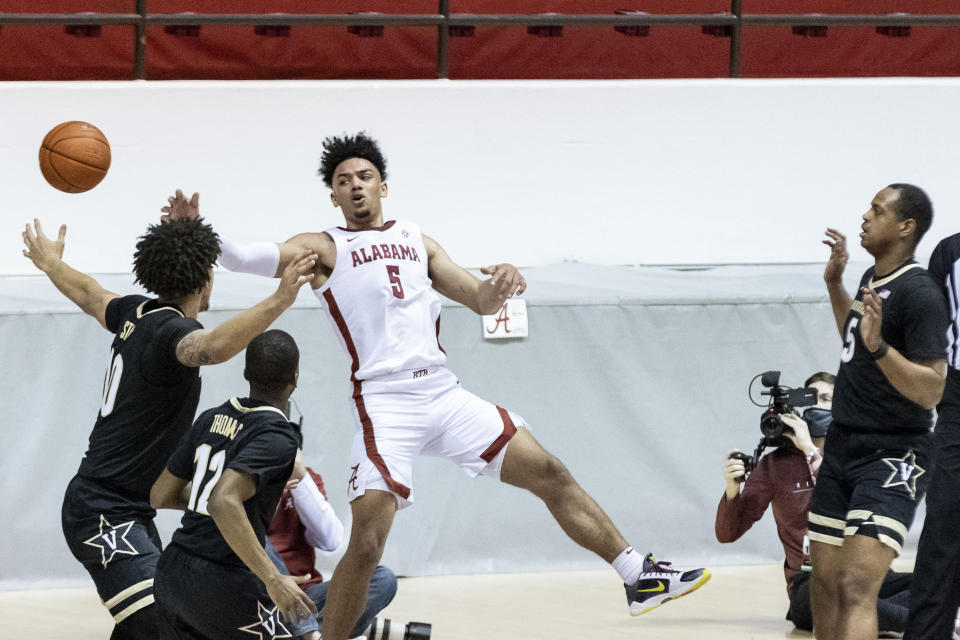 Alabama guard Jaden Shackelford (5) gets a pass away while falling out of bounds against Vanderbilt during the first half of an NCAA basketball game on Saturday, Feb. 20, 2021, in Tuscaloosa, Ala. (AP Photo/Vasha Hunt)