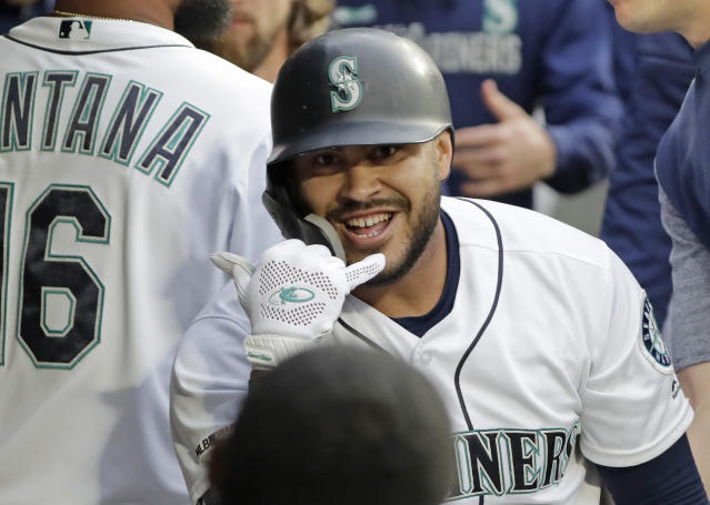 Seattle Mariners' Omar Narvaez celebrates with teammates in the dugout after he hit a solo home run against the Baltimore Orioles during the second inning of a baseball game Thursday, June 20, 2019, in Seattle. (AP Photo/Ted S. Warren)