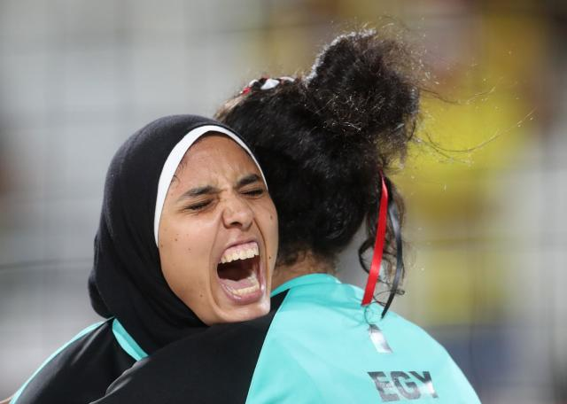 <p>Egypt's Doaa Elghobashy, left, hugs her teammate Nada Meawad, right, during a women's beach volleyball match against Germany at the 2016 Summer Olympics in Rio de Janeiro, Brazil, Sunday, Aug. 7, 2016. (AP Photo/Petr David Josek) </p>