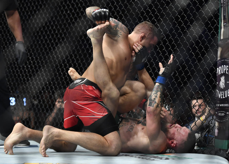 LAS VEGAS, NEVADA - JULY 10: (L-R) Dustin Poirier punches Conor McGregor of Ireland in their welterweight fight during the UFC 264 event at T-Mobile Arena on July 10, 2021 in Las Vegas, Nevada. (Photo by Chris Unger/Zuffa LLC)