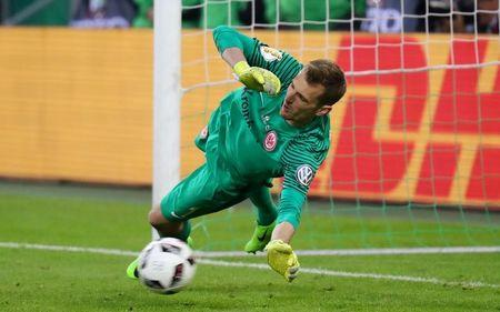 Eintracht Frankfurt's Lukas Hradecky saves a penalty taken by Borussia Monchengladbach's Djibril Sow during the penalty shootout