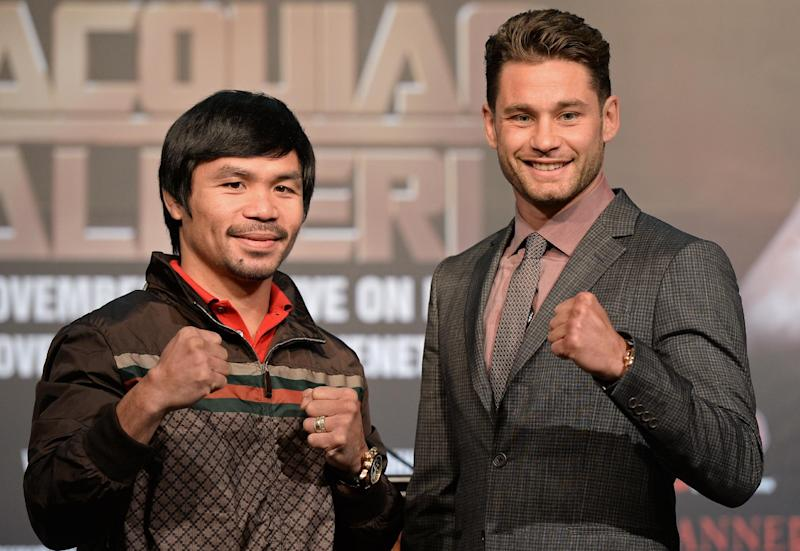 Filipino boxing legend Manny Pacquiao (L) and American Chris Algieri at a pre-fight press conference in Macau on August 25, 2014