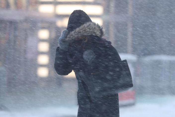 <p>A woman braces herself against the hard wind as she makes her way through Times Square in New York City during a winter snowstorm on Thursday, Jan. 4, 2018. A massive winter storm swept from the Carolinas to Maine on Thursday, dumping snow along the coast and bringing strong winds that will usher in possible record-breaking cold. (Photo: Gordon Donovan/Yahoo News) </p>