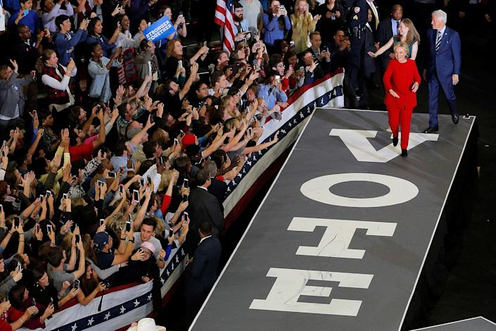 <p>U.S. Democratic presidential nominee Hillary Clinton, along with her husband, former U.S. President Bill Clinton, and their daughter Chelsea take the stage at a campaign rally in Raleigh, N.C., on Nov.8, 2016. (Photo: Brian Snyder/Reuters) </p>