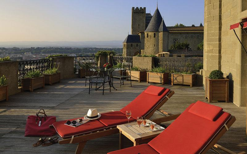 The century-old Hôtel de la Cité has rooms that are full of character, and there's a pretty garden with heated pool and views over the ramparts