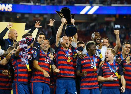 Jul 26, 2017; Santa Clara, CA, USA; United States midfielder Michael Bradley (5) hoists the trophy as he celebrates with teammates after defeating Jamaica during the CONCACAF Gold Cup final at Levi's Stadium. Mandatory Credit: Mark J. Rebilas-USA TODAY Sports