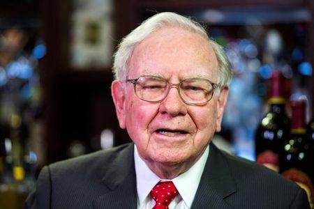 FILE PHOTO - Warren Buffett takes part in interviews before a fundraising luncheon for the nonprofit Glide Foundation in New York