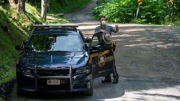 PHOTO: A New York State Trooper stands guard outside the home of attorney Roy Den Hollander, who was found dead after allegedly killing the son of federal judge Esther Salas and wounding her husband, in Catskills, N.Y., July 20, 2020. (Eduardo Munoz/Reuters)